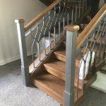 Фото деревянной лестницы с ковкой